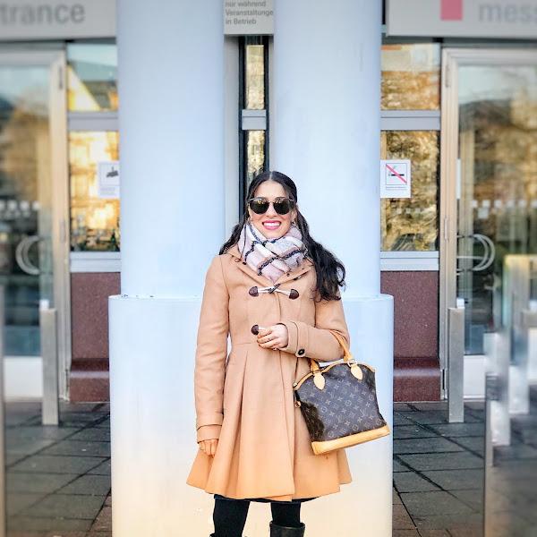 Style: Winteroutfit mit camelfarbenen Mantel, DUNE Boots und Rayban Sonnenbrille