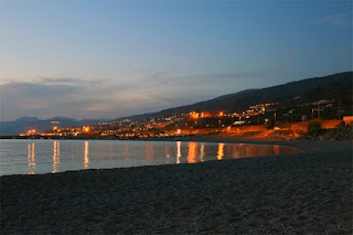 The waterfront at Paolo, captured in a photo taken on a summer's evening