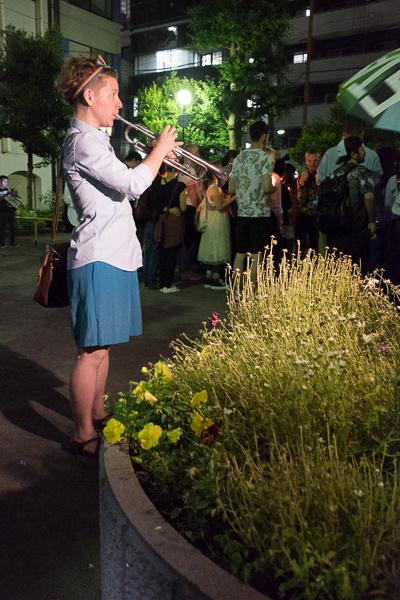 "Trumpeter plays ""We Shall Overcome""  at candlelight vigil and march for Orlando shooting victims, Shinjuku, Tokyo."