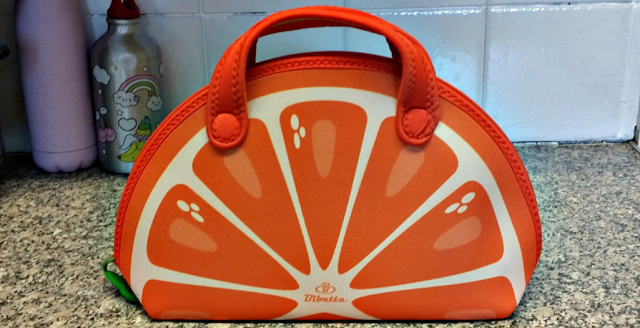 A lunch bag in the shape of an orange slice