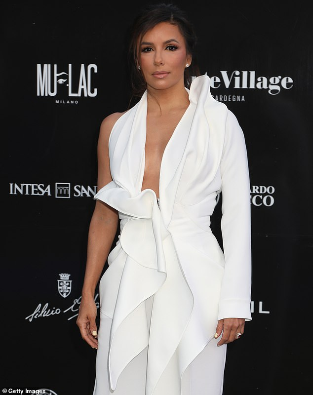 Eva Longoria glowing in a deeply plunging white jumpsuit