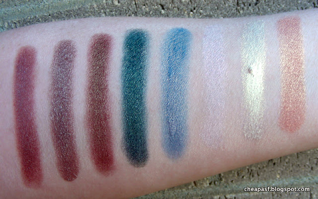 Swatches of Wet N Wild Comfort Zone, Prestige Total Intensity eyeshadow in Bewitched, Makeup Geek Ritzy, Makeup Geek Typhoon, Maybelline Color Tattoo in Seashore Frosts, Blend Mineral Cosmetics PIG3, City Color Mousse in White Gold, and e.l.f. Baked Eyeshadow in Enchanted