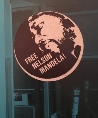 "Sticker depicting Nelson Mandela on the cover of The Special AKA's ""In The Studio"" LP"