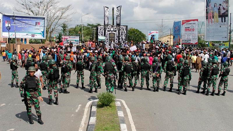 Indonesian soldiers stand guard during a protest in Timika, Papua province