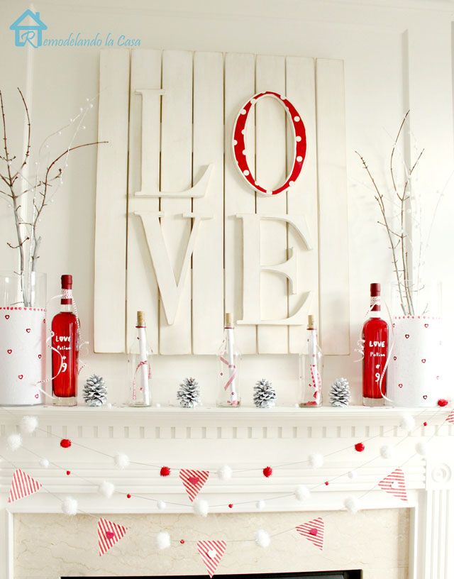 white and red mantel with LOVE wall plaque