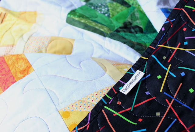 black quilt backing with confetti colors