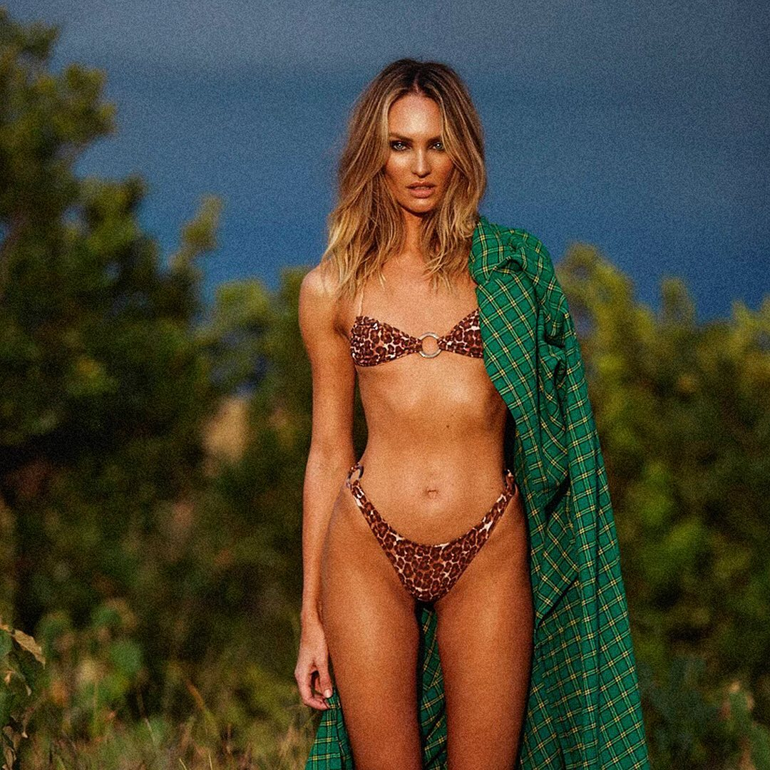 Candice Swanepoel says she looks a little 'wild' while posing in leopard-print string bikini in her native South Africa