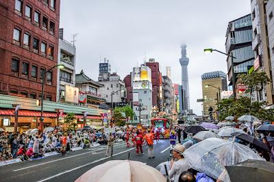 35th Asakusa Samba Carnival in Asakusa, Tokyo with Skytree behind.