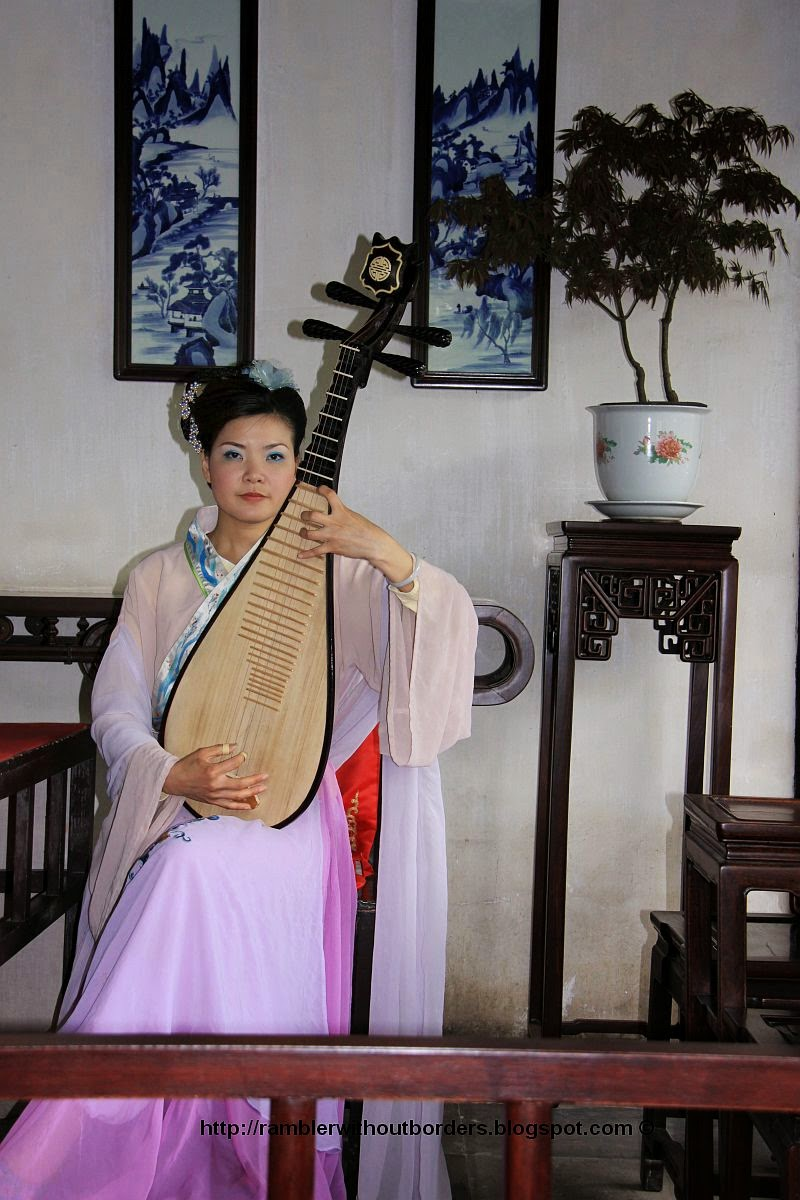 Pipa player in Chinese classical costume, China