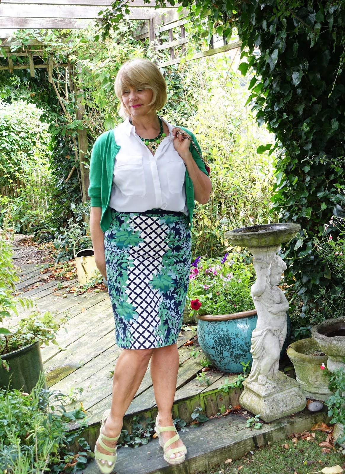 Over 50s blogger Gail Hanlon in green patterned skirt green cardigan and white blouse