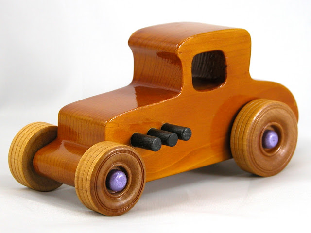 Left Front -  Wooden Toy Car - Hot Rod Freaky Ford - 27 Coupe - Pine - Amber Shellac - Metallic Purple Hubs