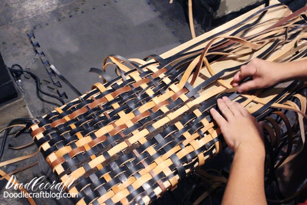 Step 3: Weaving! Then move to the front face of the bench. Repeat the tacking in process, but leave a space in between the strips. Our leather was too thick to weave if they are all tacked side by side.  Then start the fun process of weaving! Over, under, over, under, etc. Pull the leather firmly and tack the strip on the other side of the bench. Repeat for the next strip.  Pull the leather as tightly to the next as you can, keeping it as straight as possible.
