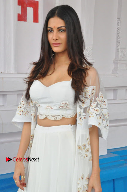 Telugu Actress Amyra Dastur Stills in White Skirt and Blouse at Anandi Indira Production LLP Production no 1 Opening  0020