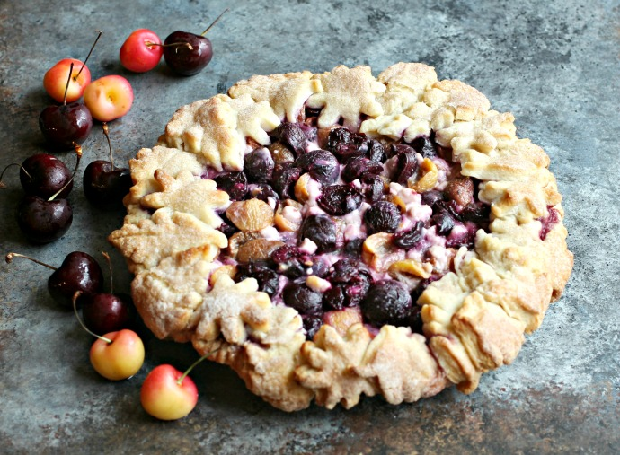 Recipe for a cherry and goat cheese pie with a decorated all butter crust.