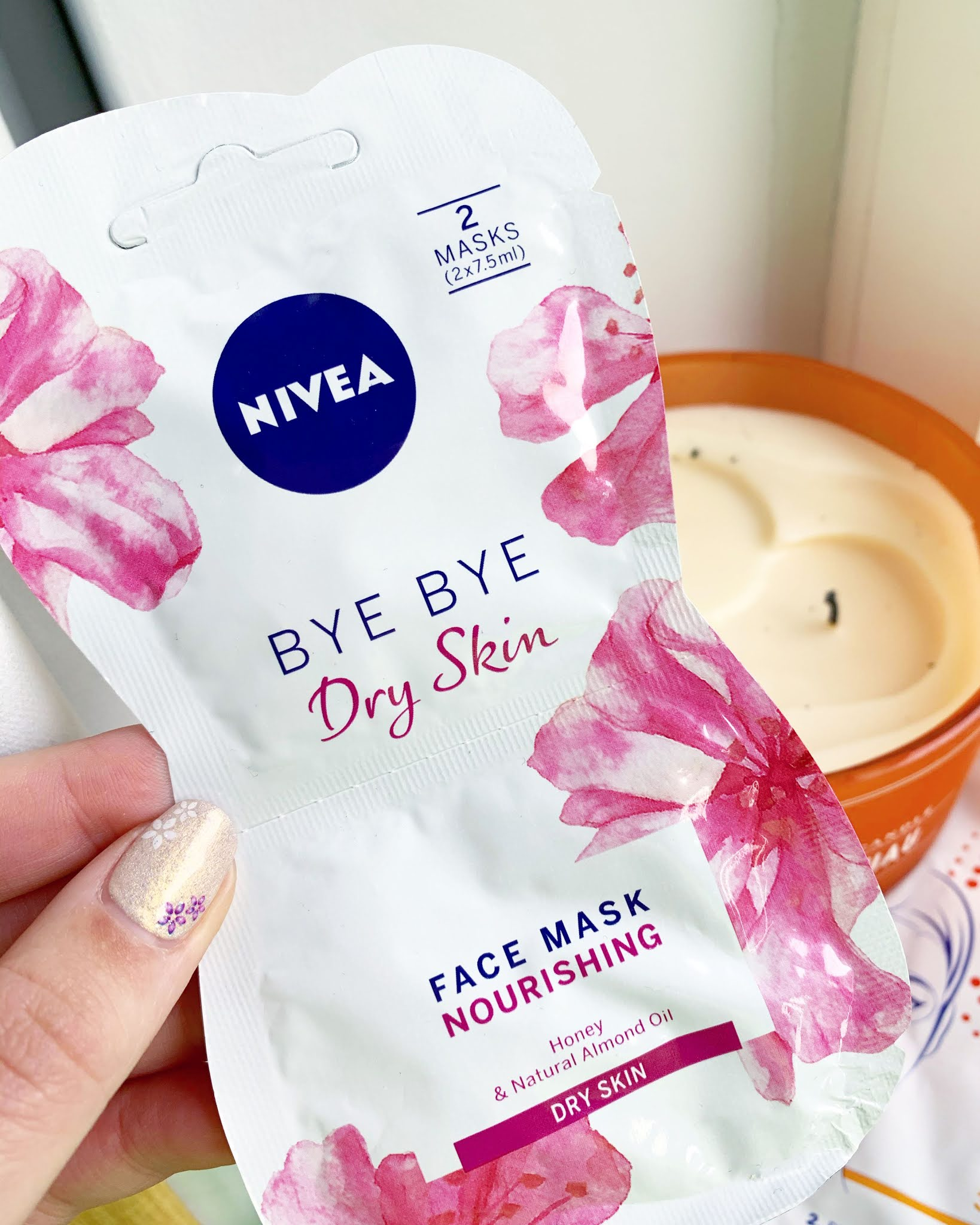 Nivea Bye Bye Dry Skin Face Mask held up