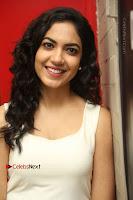 Actress Ritu Varma Stills in White Floral Short Dress at Kesava Movie Success Meet .COM 0138.JPG
