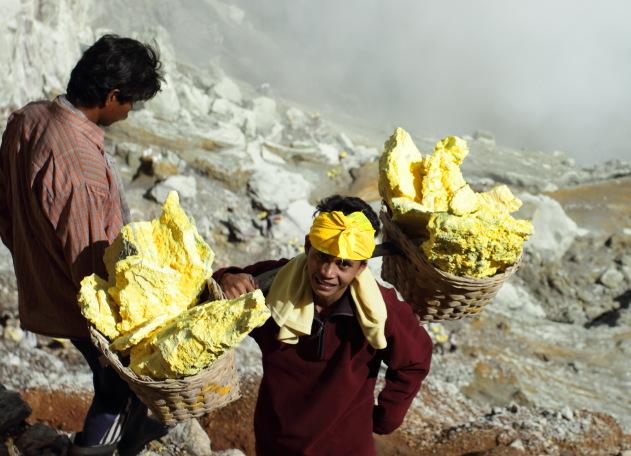 A Kawah Ijen Sulphur Miner with traditional headgear
