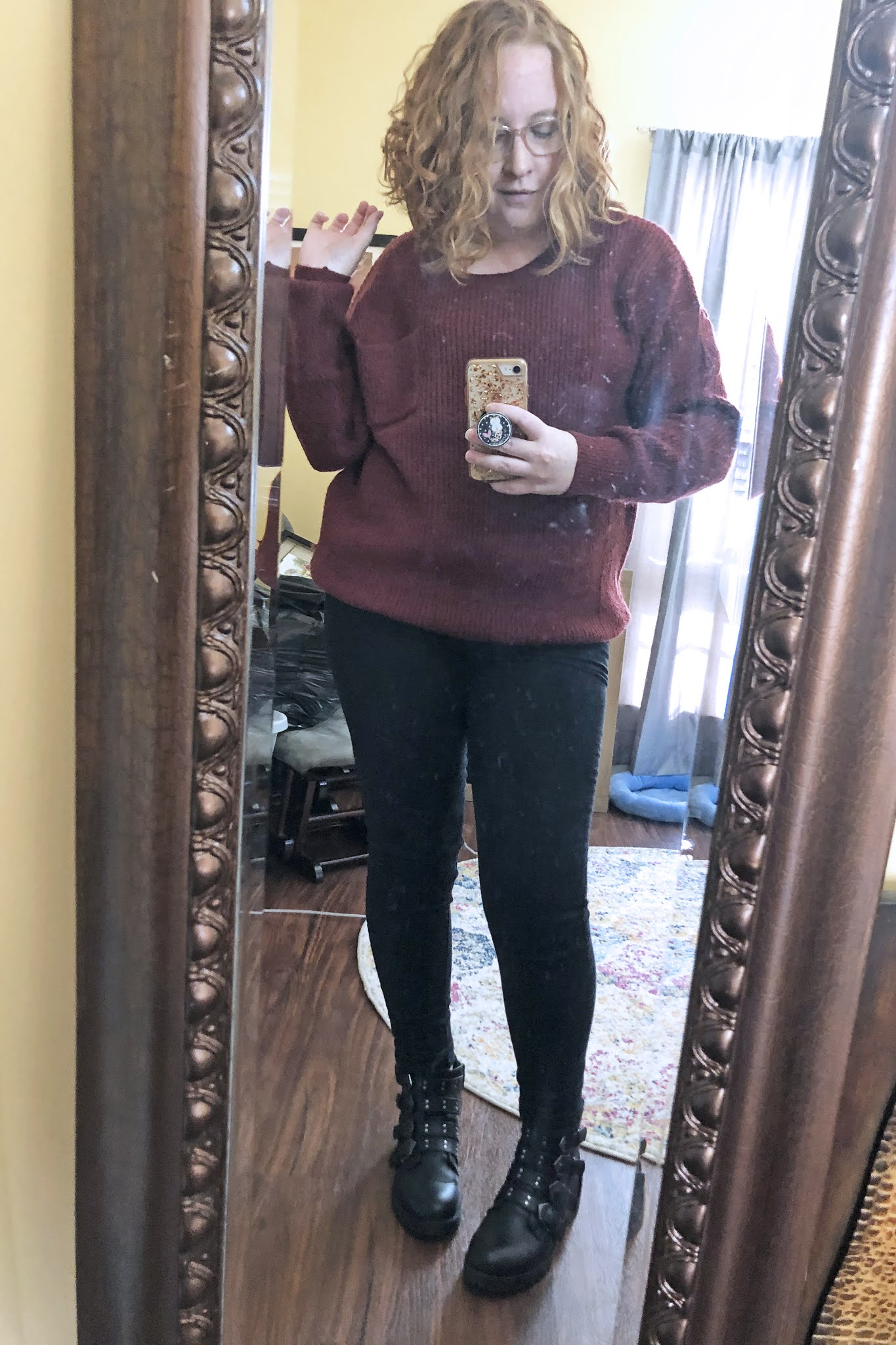 moto boots black jeans slouchy sweater