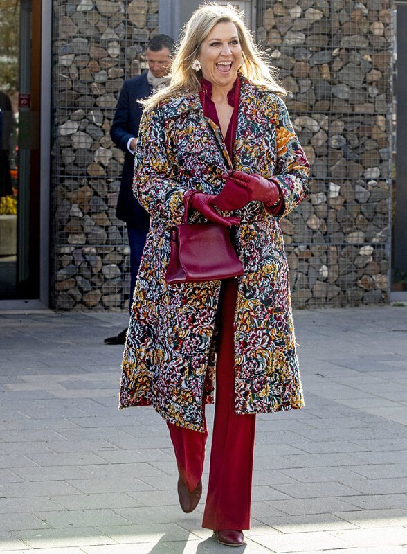 Queen Maxima wore a floral brocade long coat from Oscar de la Renta, and red LaPerm blazer, Lykoi trousers and Korat red blouse from Claes Iversen