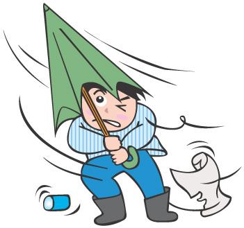 台風…傘を萎めて強風に耐えている