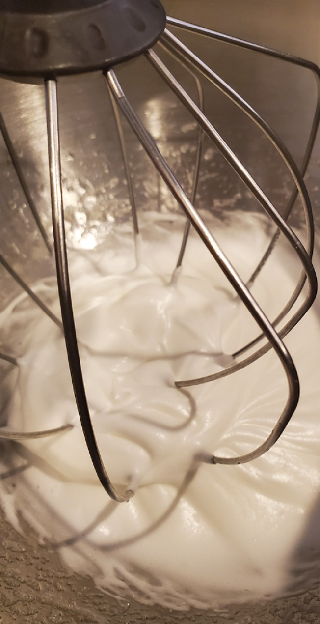 this is an electric beater making meringue using egg whites