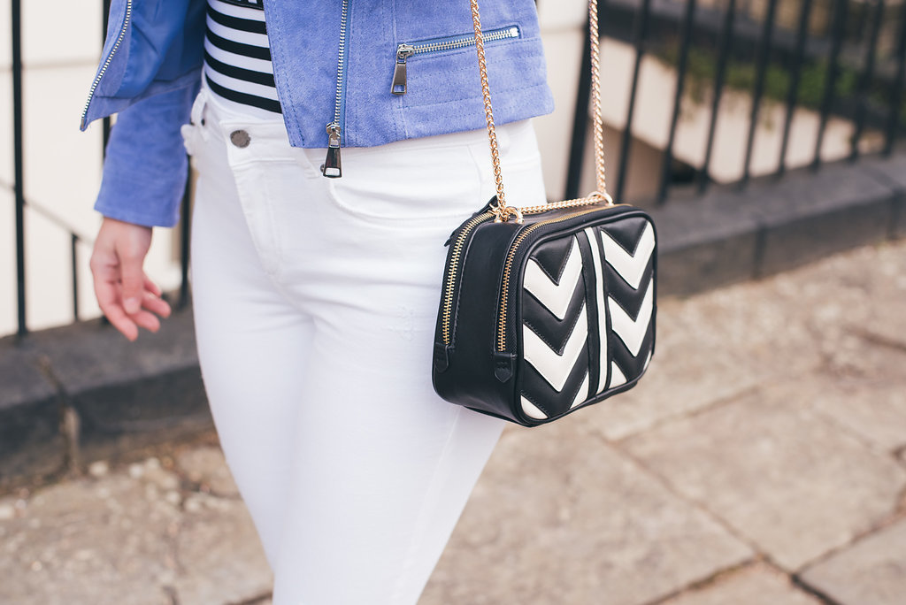 Close Up of white jeans, monochrome bag and stripe top