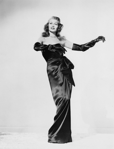 "Rita Hayworth posed in black evening gown from scene in movie ""Gilda"""