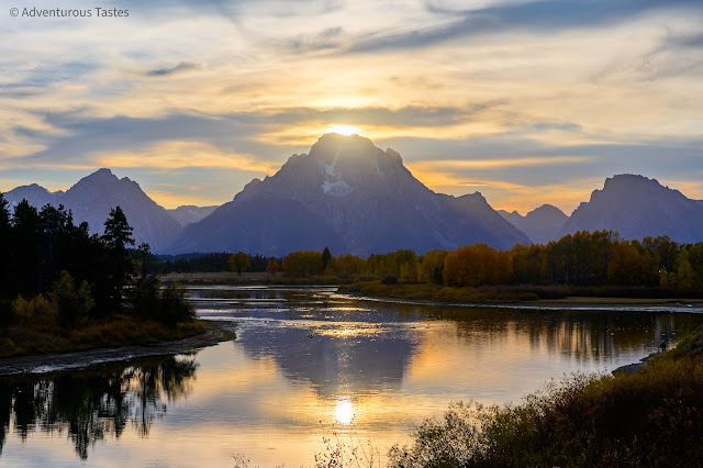 Adventurous Tastes | Golden light over mountains and river