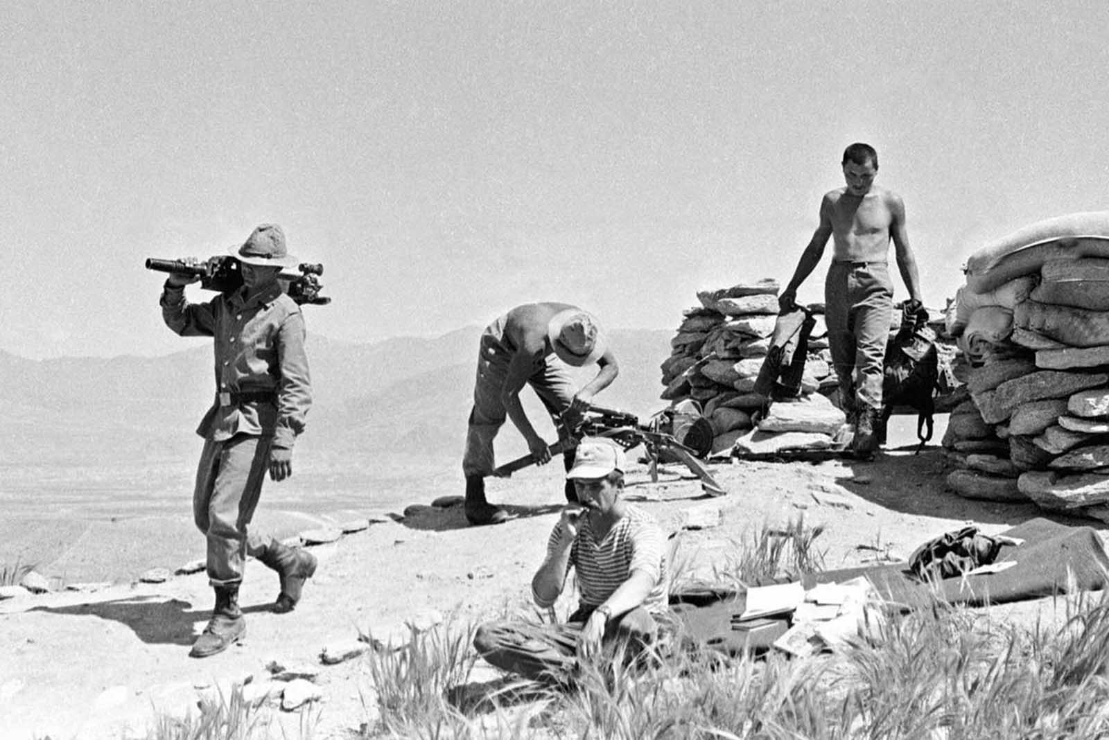 In this late April 1988 photo, Soviet soldiers prepare to change their position while fighting Islamic guerrillas at undisclosed location in Afghanistan.
