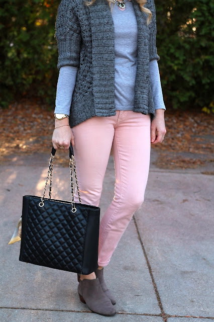grey sweater paired with blush jeans, black floppy hat, booties and black tote