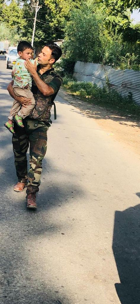 Sopore encounter: Police save 3-year-old from getting hit by bullets,New Delhi, News, Killed, Injured, Twitter, Child, Police, Jammu, Kashmir, National