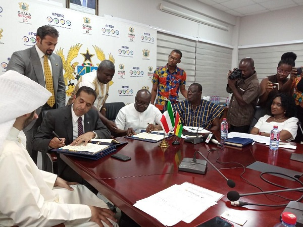 Finance Minister, Ken Ofori-Atta signing the agreement with the reps from Kuwait