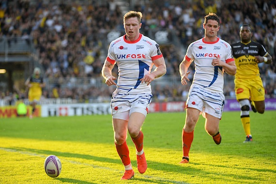 Chris Ashton and Luke James of Sale Sharks chase a rugby ball