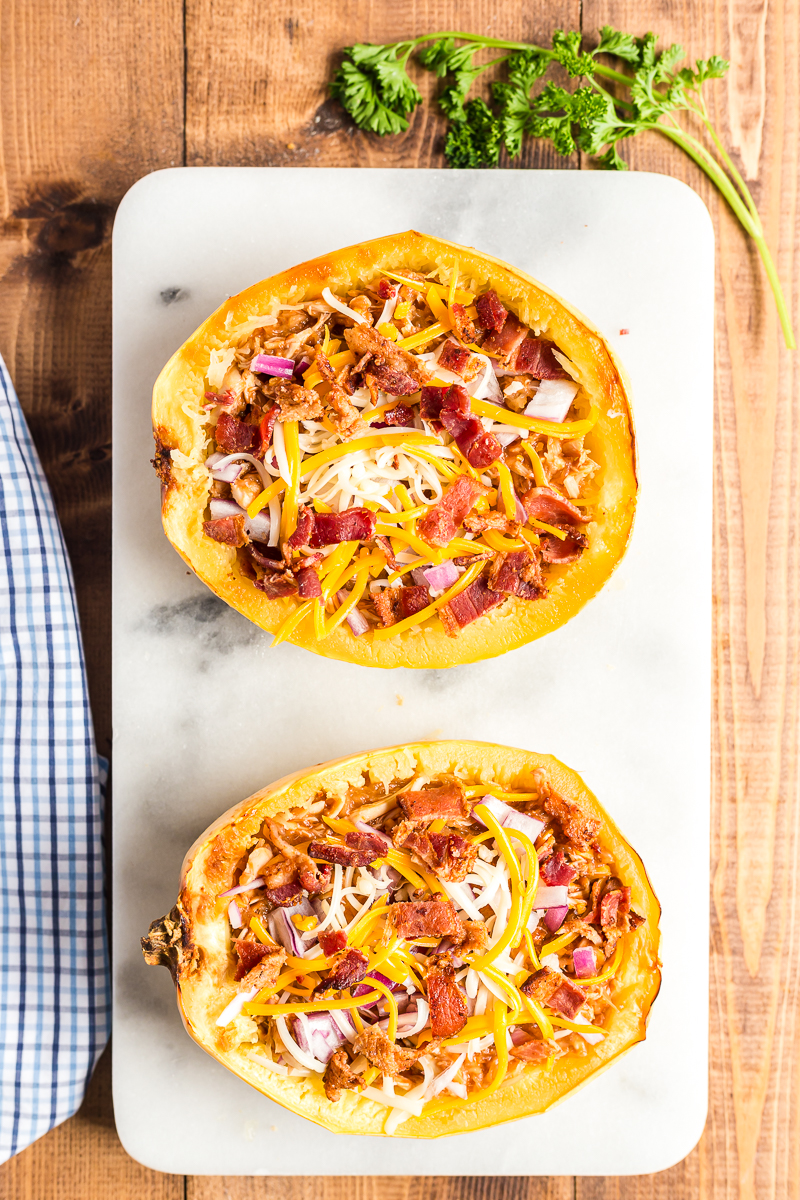 This BBQ Chicken Spaghetti Squash is the perfect low carb way to enjoy your favorite pizza flavors. #lowcarb #keto #glutenfree #spaghettisquash #BBQ #Barbecue #chicken #recipe | bobbiskozykitchen.com