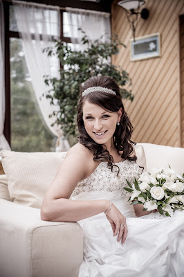 Smiling bride in Aberdeenshire with wedding hairstyle by Louise Chrystal