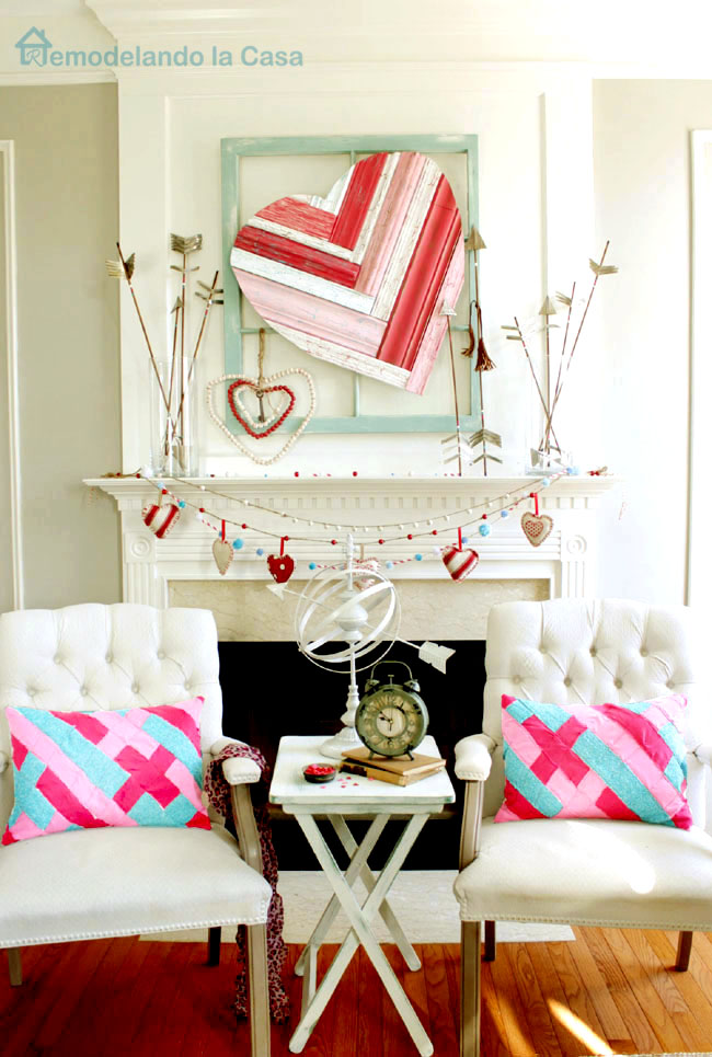 Valentine mantel with red, pink and aqua colors.