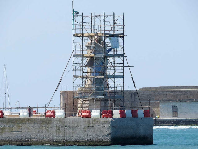 Scaffolding protecting the statue of Our Lady of the Peoples, Madonna dei Popoli, port of Livorno