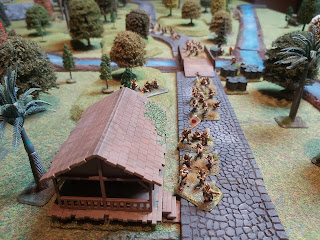 Japanese infantry cross the bridge at Gemas