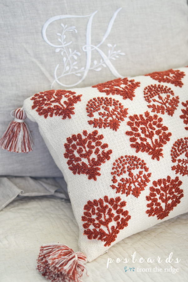 rust and cream embroidered pillow with tassels from Serena and Lily