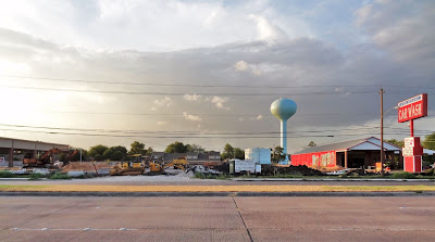 12836 Westheimer new office park construction site and Colonial Carwash with water tower in background (panorama view across multi-lane road)
