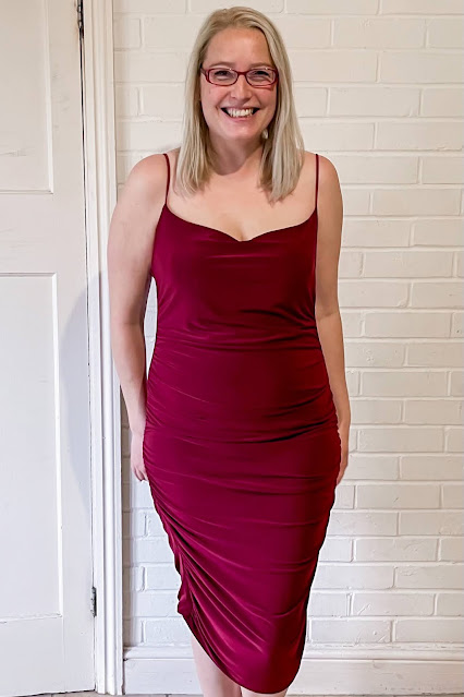 Me wearing a wine coloured midi body con dress from Femme Luxe and looking glam