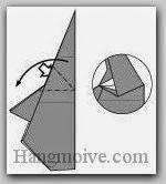Bước 11: Từ vị trí mũi tên, mở lớp giấy ra, kéo và gấp lớp giấy xuống dưới.
