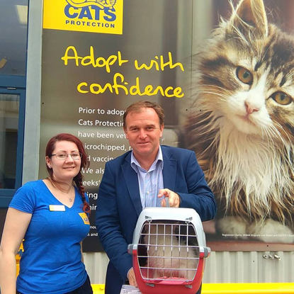 Gus being collected by George Eustice MP