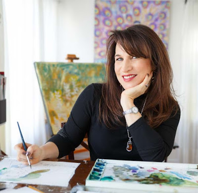 Artist Miriam Schulman painting watercolor in her home studio