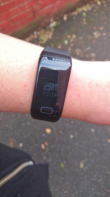 FourFit Health Band Review on Us Two Plus You - Checking my steps for the day while out is easy