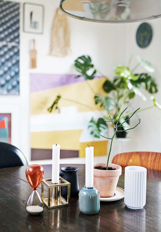 small decor pieces, monstera plant, candlesticks, home decor