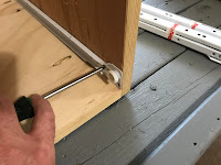 Installing the bottom slide to the cabinet