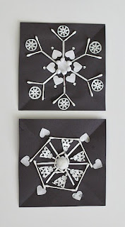 https://buggyandbuddy.com/winter-crafts-kids-create-symmetrical-snowflake/