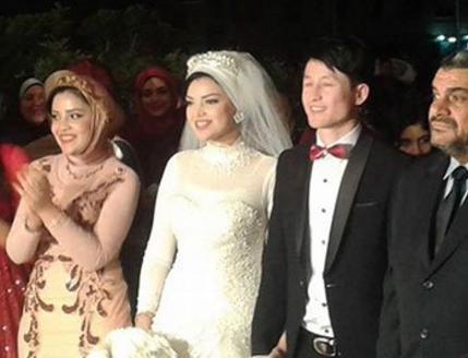 صيني يتزوج مصرية من دمياط بعد اسلامه