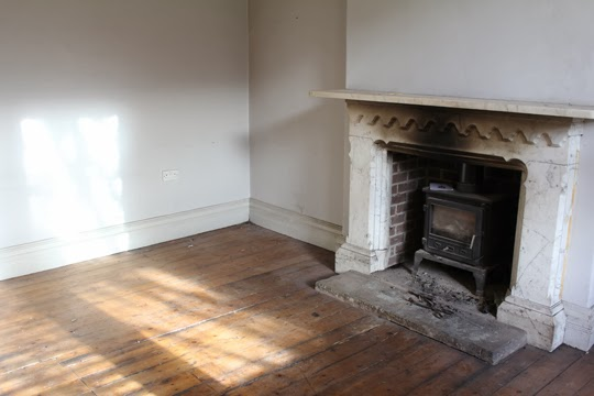 marble fireplace and wood burner